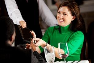 woman-paying-bill-at-restaurant